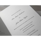 Italic black raised lettering on white matte card invitation, unfolded