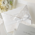 White satin lace with bow, wrapped around a pocket invite with silk screened floral pattern