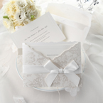 Smooth white card stock with embossed border, white floral pocket, with white satin ribbon