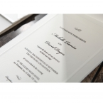 White card with embossed border, printed in black high rise calligraphic writing