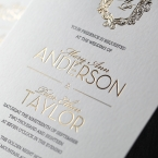 Lustrous gold foiled names and emblem with black ink calligraphic block letters, printed on a lightly textured card
