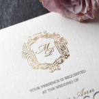 Shimmering hot gold foiled monogram with regal inspired surrounding frame with black raised ink printing