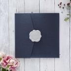 Shimmering dark navy blue invite on a pearlised card stock, sealed with a silver wax stamp