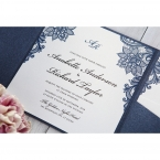 Pearl insert card with blue floral borders and black raised ink lettering set on a navy blue pocket invite