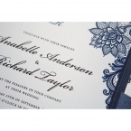 Shiny black ink letters printed in raised ink, on a pearl card stock, with sophisticated floral border design
