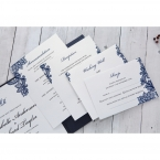 Stationeries on a pearl card stock with black calligraphic fonts and charming blue floral design