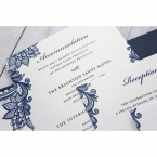 Black raised ink calligraphic writing on a matte white card, with digitally printed blue floral border