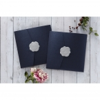 Elegant navy blue coloured pearlised pocket invite sealed with a shiny silver wax stamp seal