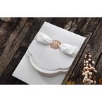 White satin ribbon with a gold foiled center, wrapped around a textured pocket