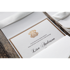 Shiny golden emblem on a white textured card stock, digitally printed calligraphic writing
