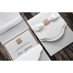 Textured white cardstock, with foiled emblem, insert card with golden edge, white lace ribbon