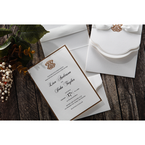 Lightly textured white card, black ink calligraphic writing, golden emblem and borders
