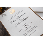 Dazzling emblem in gold foil stamped on a white textured card, digitally printed in flat ink
