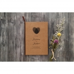 Heart shaped fingerprint in high rise ink on a craft card stock, black calligraphic writing