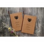 Heart shaped center on a brown craft paper invite, printed in raised black ink in calligraphic writing