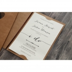 Raised ink calligraphic writing on a white textured card stock, inserted in a brown craft card, adorned with brown satin lace