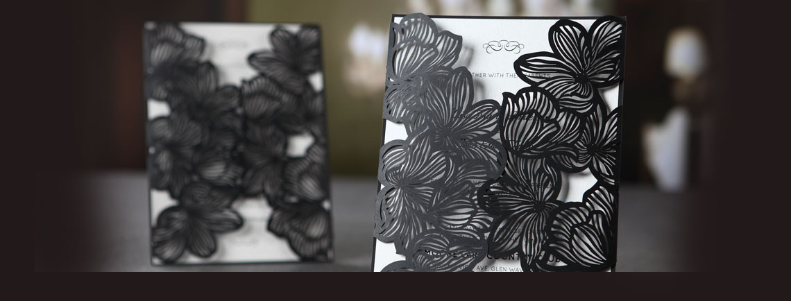 Black laser cut wedding invitation, with floral pattern