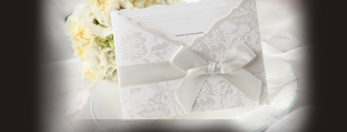 Traditional ivory pocket wedding invitation with classic bow