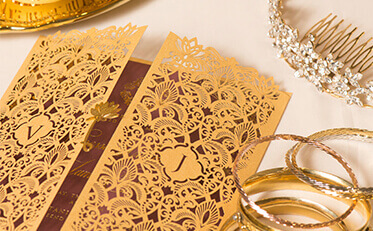 Wedding invitations in melbourne stationery wedding cards online gold moroccan themed laser cut invitation with gold trinkets placed beside the invite as decorations stopboris Gallery